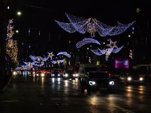 Bucharest nightlife in December with Christmas decorations on Calea Victoriei Boulevard royalty free stock photo