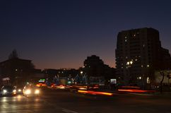 Bucharest United Nations Square at dusk. Bucharest, Romania - December 2, 2018: Cars traffic in United Nations Square at dusk. Blurred taillights of moving royalty free stock image