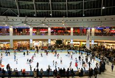 Crowded skating ring inside AFI Palace Cotroceni Mall. BUCHAREST, Romania - December 22, 2017: Crowded skating ring inside AFI Palace Cotroceni Mall. Bucharest royalty free stock images