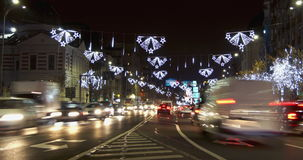 BUCHAREST - ROMANIA, December 2015, Night traffic  with car pass, Christmas decorations in Union Square, 4k time lapse. Version 5 stock video footage