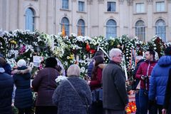 In memoriam of death of King Mihai of Romania. BUCHAREST, ROMANIA - 15 DECEMBER 2017: People gathered to bring flowers as the last homage in memory of King Mihai stock images