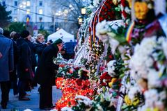 In memoriam of death of King Mihai of Romania. BUCHAREST, ROMANIA - 15 DECEMBER 2017: People gathered to bring flowers as the last homage in memory of King Mihai stock image