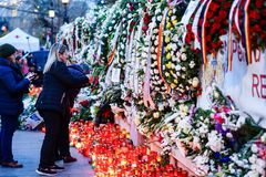 In memoriam of death of King Mihai of Romania. BUCHAREST, ROMANIA - 15 DECEMBER 2017: People gathered to bring flowers as the last homage in memory of King Mihai royalty free stock image
