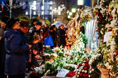 In memoriam of death of King Mihai of Romania. BUCHAREST, ROMANIA - 15 DECEMBER 2017: People gathered to bring flowers as the last homage in memory of King Mihai stock photos