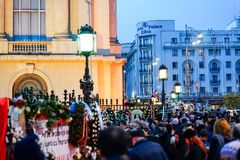 In memoriam of death of King Mihai of Romania. BUCHAREST, ROMANIA - 15 DECEMBER 2017: People gathered to bring flowers as the last homage in memory of King Mihai royalty free stock photography