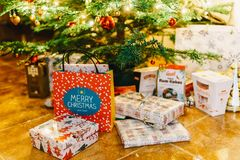 Presents And Chocolate Candies Waiting To Be Opened Under Christmas Tree Royalty Free Stock Photography