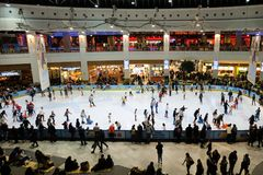 Skating ring filled with people, inside AFI Palace Cotroceni Mall. BUCHAREST, Romania - December 22, 2017: Skating ring filled with people, inside AFI Palace stock images