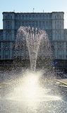 Bucharest, Romania: Fountain with parliament in background. Fountain in Bulevardul Uniri, Bucharest, Romania, with Romanian parliament building as backdrop royalty free stock photo