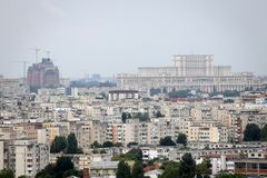 Bucharest seen from a high point, with the Palace of Parliament. BUCHAREST, ROMANIA - July 31, 2018: Bucharest seen from a high point, with the Palace of royalty free stock photos