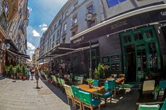 Small and picturesque street terraces with tourists, Bucharest, stock photos