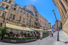 Small and picturesque street terraces with tourists, Bucharest, Stock Photography