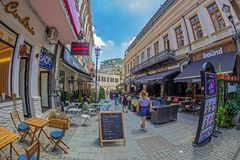 Small and picturesque street terraces with tourists, Bucharest, Royalty Free Stock Images