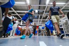 IKEA opening second store in Romania. Bucharest, Romania - June 24, 2019: Buyers and curious visitors to see how the new IKEA Pallady store looks are seen in the stock images