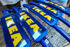 IKEA opening second store in Romania. Bucharest, Romania - June 24, 2019: Close-up with shopping carts bearing the IKEA logo taken in the opening day of the IKEA royalty free stock images