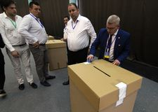 National Liberal Party elections - Romania. Bucharest, Romania - June 17, 2018: Deputy Florin Roman prepares the ballot boxes for the PNL president`s election at stock photos