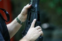 Details of a soldier holding a Beretta ARX 160 tactical rifle. Bucharest, Romania - June 10, 2019: Details of a soldier holding a Beretta ARX 160 tactical rifle royalty free stock image
