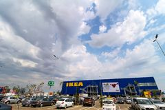 IKEA opening second store in Romania. Bucharest, Romania - June 24, 2019: The IKEA building and the parking next to it are seen in the opening day of the IKEA stock image