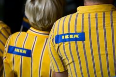IKEA opening second store in Romania. Bucharest, Romania - June 24, 2019: IKEA staff dressed in uniforms are waiting the first buyers in the opening day of the royalty free stock photography