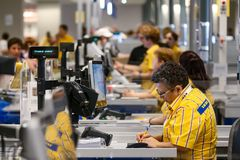 IKEA opening second store in Romania. Bucharest, Romania - June 24, 2019: IKEA working staff at the cash registers are seen in the opening day of the IKEA stock images