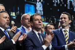National Liberal Party elections - Romania. Bucharest, Romania - June 17, 2018: Ludovic Orban (C) enjoys together with Ioan Balan (L) and Robert Sighiartau (R) stock photography