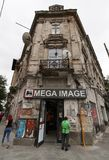 Mega Image store in a very poor building - Bucharest, Romania royalty free stock image