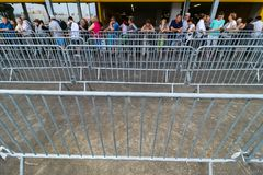 IKEA opening second store in Romania. Bucharest, Romania - June 24, 2019: People are waiting in a fencing lane area to enter, in the opening day, in the new IKEA stock images