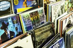Vinyl Record Cases Of Famous Music Bands For Sale In Music Store royalty free stock images