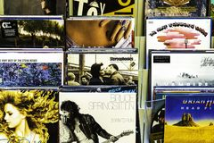 Vinyl Record Cases Of Famous Music Bands For Sale In Music Store stock photos