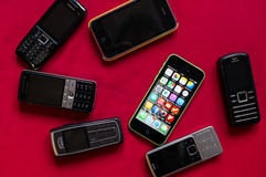 Free BUCHAREST, ROMANIA - MARCH 17, 2014: Photo Of Iphone Versus Old Nokia Phones On A Red Background Showing The Evolution Of Mobile Royalty Free Stock Image - 47077276