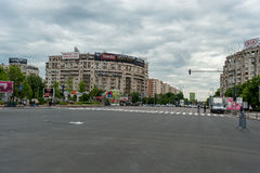BUCHAREST, ROMANIA - MAY 30, 2017: Bucharest Cityscape with Shopping Mall and Empty Street. Royalty Free Stock Images