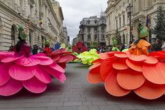Bucharest, Romania - May 30, 2014: Female dancers in exotic colorful carnival costumes present The Giant Flowers show. During the B-Fit International Street Royalty Free Stock Photography