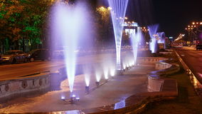 Bucharest, Romania Night Timelapse of the Water Fountains at Union Square (Piata Unirii). A night timelapse traffic view of the water fountains at Union Square ( stock video