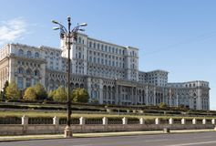 Building of Palace of Parliament on the Constitution Square in Bucharest city in Romania royalty free stock photography