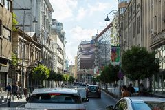 Modern and old buildings on Calea Victoriei street in Bucharest city in Romania. Bucharest, Romania, October 10, 2017 :  Modern and old buildings on Calea Royalty Free Stock Image