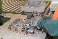 Bucharest, Romania - October, 2013: Workers disassembling electronic components of used television sets and preparing them to be. Recycled on a recycling plant royalty free stock image