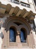 Bucharest, Romania: Ornamental window near Piata Romana Royalty Free Stock Photography