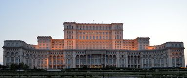 Bucharest Romania: Palace of the Parliament (Palatul Parlamentului) in evening light. Ceausescu's Casa Poporului (House of the People) now the Palace of the royalty free stock photo