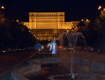 Bucharest Romania: Parliament from Fountains at Night. View of coloured fountains along Bulevard Unirii at night with Parliament building in background in stock images