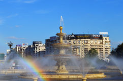 Bucharest, Romania: Rainbow in the fountain at Piata Unirii. Water spraying in the fountain acts as a prism splitting the light into a rainbow stock images