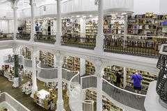 BUCHAREST, ROMANIA - SEPTEMBER 27, 2015: People Shopping For Literature Books In Carturesti Library, considered the most beautiful. Library l in Bucharest Royalty Free Stock Image