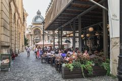 Historical center in Bucharest, Romania. Bucharest, Romania - September 9, 2017: Tourists visiting the historical center of Bucharest with its beautiful royalty free stock photo