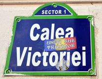 Bucharest Romania: street sign with political campaign slogan. Sign for the main shopping street in Bucharest. The slogan 'Unity under the Tricolour' refers to stock photography