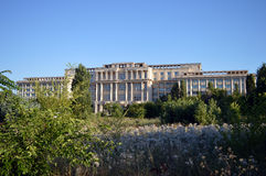 Bucharest, Romania: Unfinished and overgrown building of the Romanian Academy. The headquarters of the Romanian Academy (Academia Romania) was a project royalty free stock photography