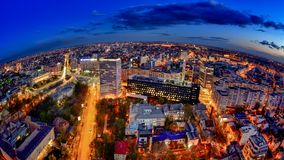 Bucharest skyline in the Victoria Square , aerial view. Panoramic view ,city lights , night-scene, blue hour , after sunset , modern building royalty free stock image