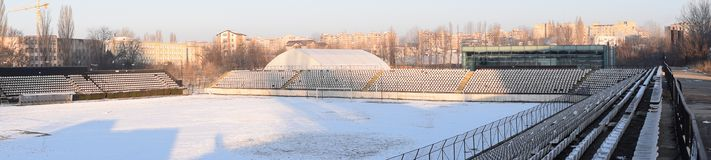 Bucharest, Sportul Studentesc stadium in the winter. Panorama of empty stadium covered in snow. Bucharest, Sportul Studentesc stadium in the winter. Panorama of royalty free stock photo
