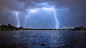 Bucharest summer lightning storm in Herastrau lake Stock Photos