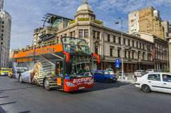 Bucharest tour bus. Bucharest city tour bus with tourists visiting capital of Romania in double decker bus. The bus offers tourists complete tour of the most Stock Images