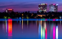 Bucharest tower at night reflecting on water royalty free stock photo