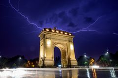 Bucharest Triumph Arch in the light storm by night. Bucharest lightning storm in the summer at the Arch of Triumph Stock Photography