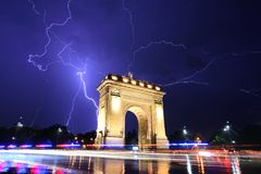 Bucharest Triumph Arch in the light storm by night. Long exposure, lightning strike Stock Images